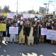 Teachers and Staff of University of Balochistchant slogans against non-payment of their dues salaries during protest demonstration — Stock Photo #36655739