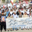 Stock Photo: Activists of MuttehidQaumi Movement (MQM) chant slogans against Sindh Local Government Bill, during protest demonstration at Sukkur press club