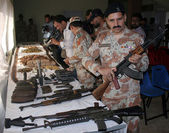 Rangers officials showing recovered seized weapons during intelligence based targeted operation at Peoples Sports Complex — Stock Photo