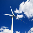 Royalty-Free Stock Photo: Wind turbine against blue sky