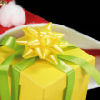 Yellow gift in Santa Hat - Stock Photo