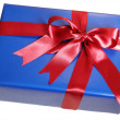 Blue gift box with red ribbon — Stock Photo