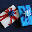 Two presents on black background — Stock Photo