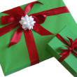 Green present with red ribbon — Stock Photo