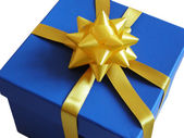 Blue gift box with yellow ribbon — Stock Photo