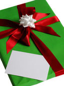 Green present with white card — Stock Photo