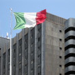 Office building with an Italian flag - Stock Photo