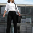Motivated career woman in front of her office — Stock Photo