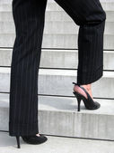 Success Steps - Woman with high heels on the stairs of success — Stock Photo