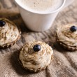 Raw food cupcakes with a cup of coffee - Stock Photo