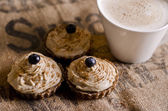 Raw food cupcakes with a cup of coffee — Stock Photo