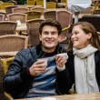 Happy Couple Holding Coffee Cups At Restaurant — Stock Photo