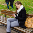 Pickpocket Stealing Bag While Woman Using Phone On Park Bench — Stock Photo #38169251
