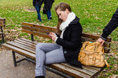 Pickpocket Stealing Bag While Woman Using Phone On Park Bench — Stock Photo