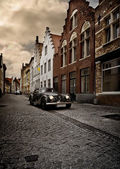 Old Car in old Town — Stock Photo