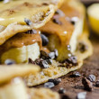 Stock Photo: BananAnd Choco Chips Pancake With Syrup On It
