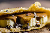 Pancake Made With Bananas, Choco Chips And Syrup — Stock Photo