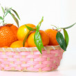 Pink basket with tangerines — Stockfoto