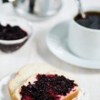 Bread with jam and cup of coffee — Stock Photo