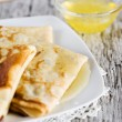 Pancakes with honey — Stockfoto