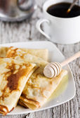 Pancakes with honey and coffee — Stock Photo