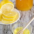 Royalty-Free Stock Photo: Honey and lemons