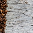 Coffee beans on old wood background — Stock Photo #12733060