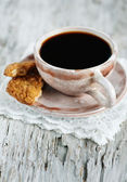 Cup of coffee and broken cookie — Foto de Stock