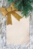 Christmas congratulation card with golden bow — Stock Photo