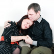 Man comforting her woman - Stock Photo