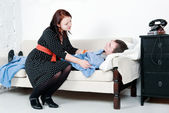 Woman take care of her sick man — Stock Photo