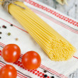Spaghetti, dry pepper, tomatoes and garlic — Stock Photo