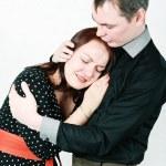 Man comforting his crying woman — Stock Photo #18852073
