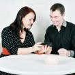Man and woman talking using telephone — Stock Photo