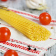 Spaghetti, dry pepper, tomatoes and garlic — Stock Photo #22704569