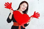 Woman with red heart toy — Stock Photo