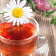 Herbal tea with chamomile and clover — Stock Photo
