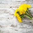 Dandelion flowers on the wooden background — Stock fotografie