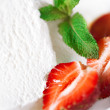 Ice cream with strawberry and mint leaves — Stock Photo