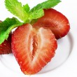 Strawberries and mint leaves — Stock Photo