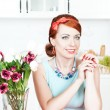 Beautiful smiling woman on the kitchen — Stock Photo