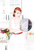 Beautiful woman with vinyl record — Stock Photo