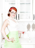 Stylish beautiful housewife pouring tea — Stock Photo