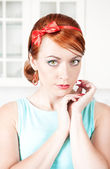 Portrait of stylish beautiful woman with red hair — Stock Photo