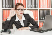 Business woman eavesdropping — Stock Photo