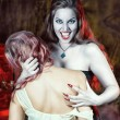 Stock Photo: Beautiful vampire and her victim
