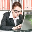 Stock Photo: Frown business womworking