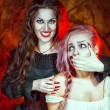 Halloween witch and her victim — Stock Photo #31020247