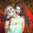 Stock Photo: Halloween vampire and her victim