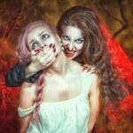 Halloween vampire and her victim — Stock Photo #31175331